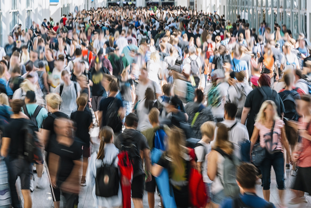 crowd of blurred people at a trade fair
